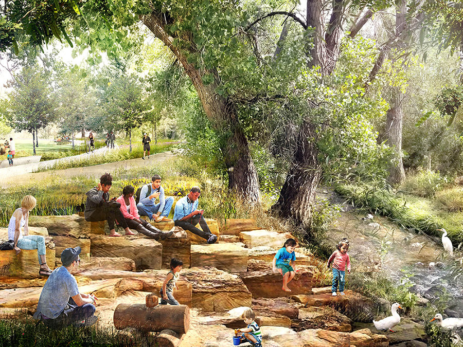 a sunlit riverside park and stones with people enjoying themselves